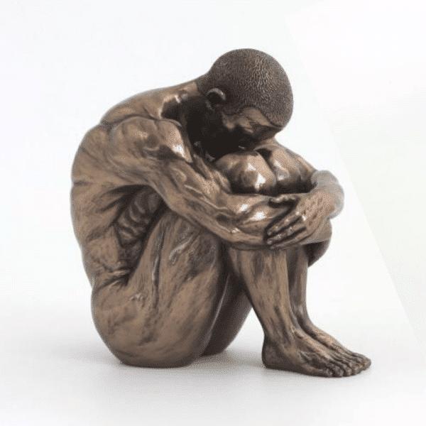 Figurine représentant un gymnaste assis