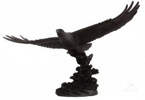 Figurine d'un aigle volant majestueusement